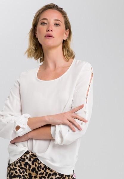 Bluse mit Ziererlenknöpfen