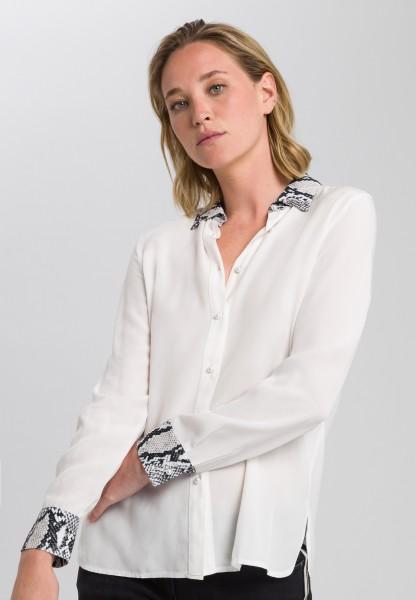 Bluse mit Schlangendruck-Details
